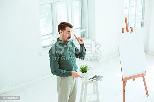 821463698 istock photo Speaker at Business Meeting in the conference hall 699939680