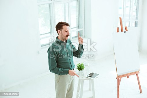 821463698 istock photo Speaker at Business Meeting in the conference hall 699941982