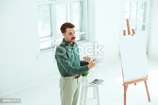 821463698istockphoto Speaker at Business Meeting in the conference hall 699944270