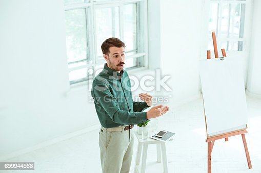 821463698istockphoto Speaker at Business Meeting in the conference hall 699944566