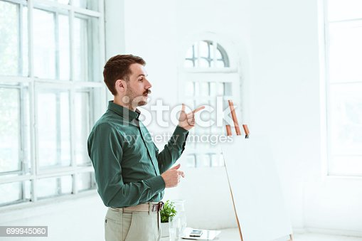 821463698 istock photo Speaker at Business Meeting in the conference hall 699945060