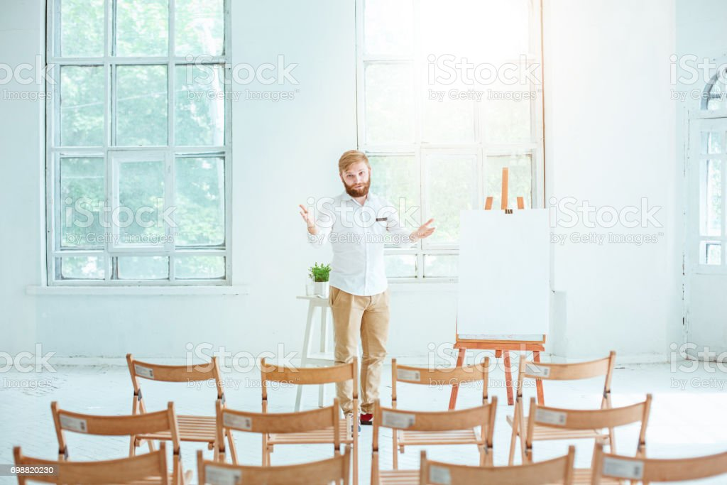 Speaker at Business Meeting in the empty conference hall stock photo