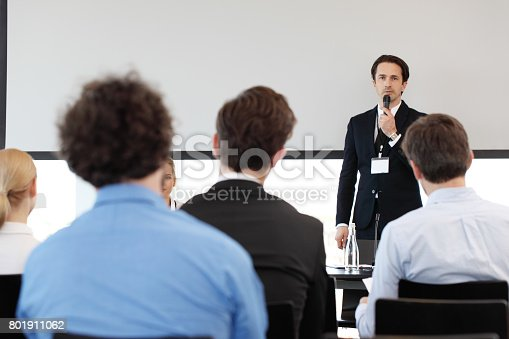 istock Speaker at conference 801911062