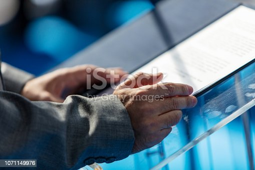 854811490 istock photo Speaker at lectern 1071149976