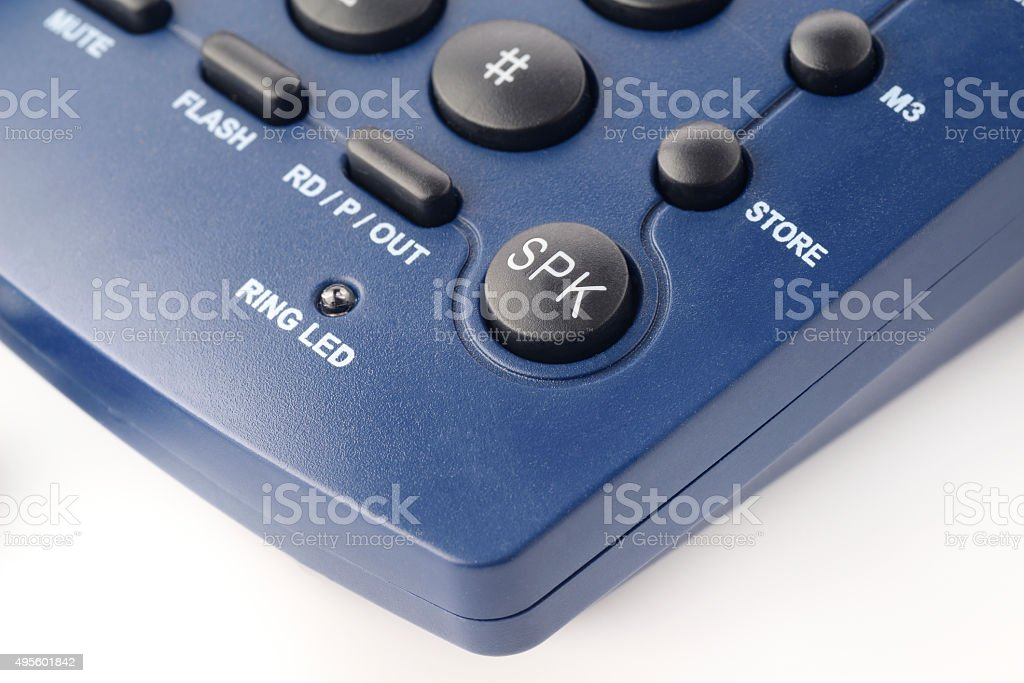 Speaker Button on a modern landline phone in blue color stock photo