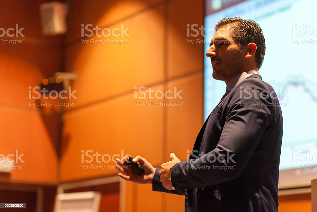 Speaker giving talk at Business Conference. stock photo
