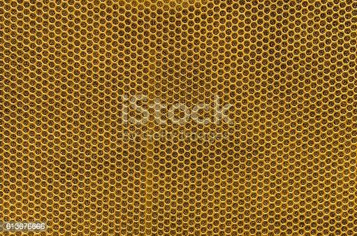 istock Speaker grille, Golden metal background 613676666