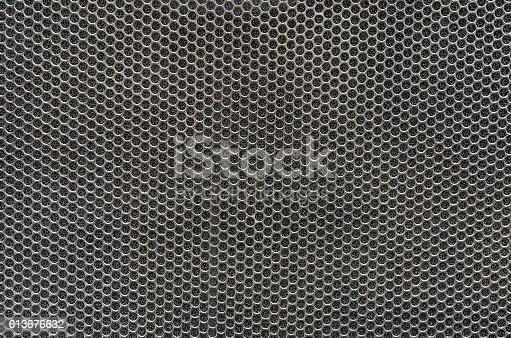 istock Speaker grille, Metal background 613676632
