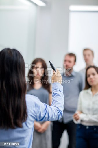 637940820 istock photo Speaker leading meeting in conference room 637901088