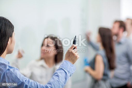637940820 istock photo Speaker leading meeting in conference room 637901144