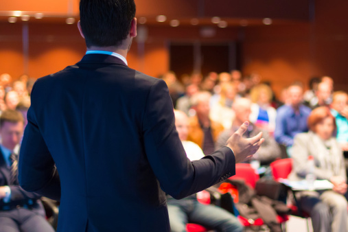 Speaker Presenting At Business Seminar Stock Photo - Download Image Now