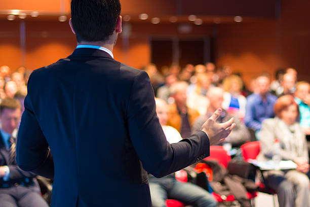 Speaker presenting at business seminar Speaker at Business Conference and Presentation. Audience at the conference hall. speech stock pictures, royalty-free photos & images