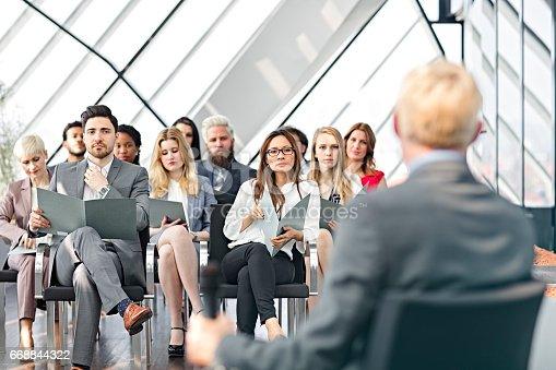 istock Speaker presenting at business seminar 668844322