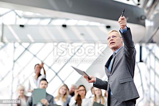 istock Speaker presenting at business seminar 668846438