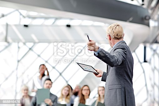 istock Speaker presenting at business seminar 668846476