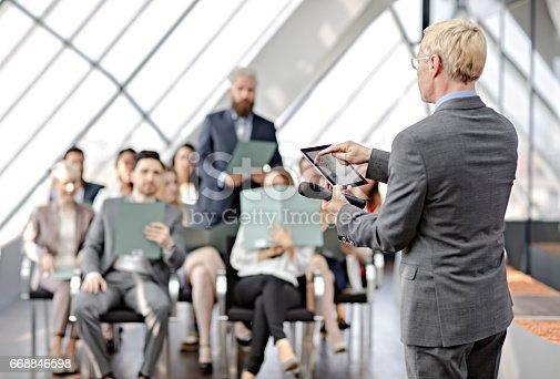 istock Speaker presenting at business seminar 668846598
