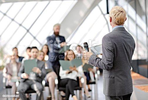 istock Speaker presenting at business seminar 668846848