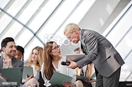 istock Speaker presenting at business seminar 668847028