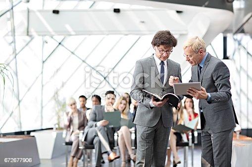 istock Speaker presenting at business seminar 672677906