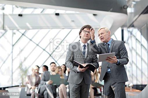 istock Speaker presenting at business seminar 672677948