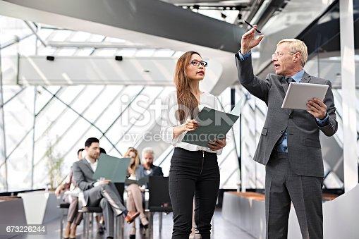 istock Speaker presenting at business seminar 673226244