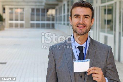 Speaker showing his id badge.