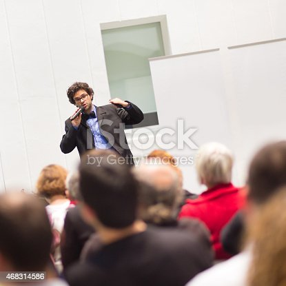 istock Speaker Talking at Business Conference. 468314586