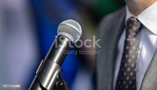 854811490 istock photo Speaking at conference 1071145088