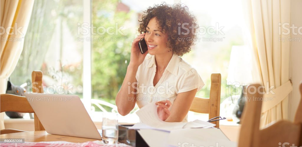 speaking to a happy customer stock photo