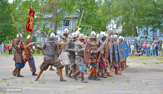 Vologda, Russia - June 30, 2018: At the celebration of the city day in Vologda, men put on military uniforms of ancient Russia and demonstrate the battle in the stadium near the school 10.