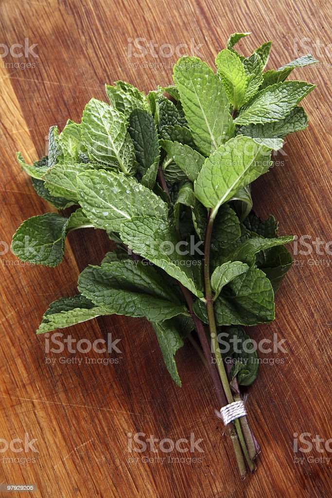 Spearmint on wood royalty-free stock photo