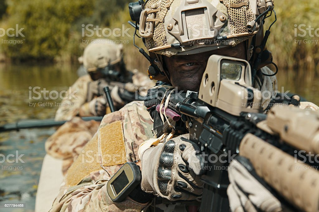 Spec ops in the military kayak stock photo