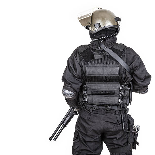 Spec ops Spec ops soldier in black uniform and face mask shot from behind counter terrorism stock pictures, royalty-free photos & images
