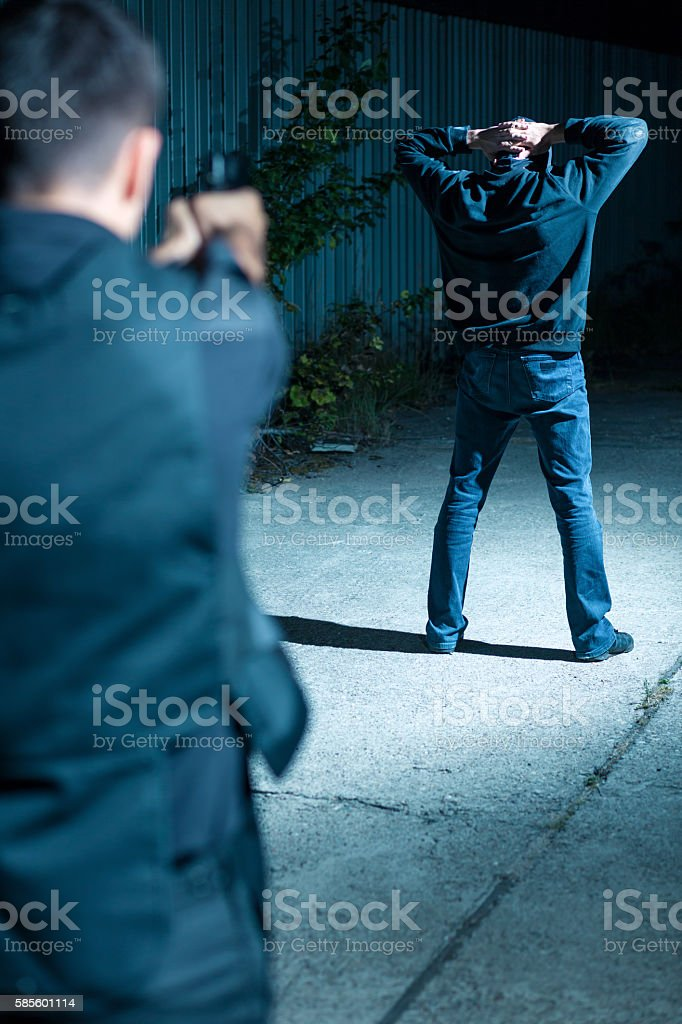 Special agent chasing after gangster stock photo