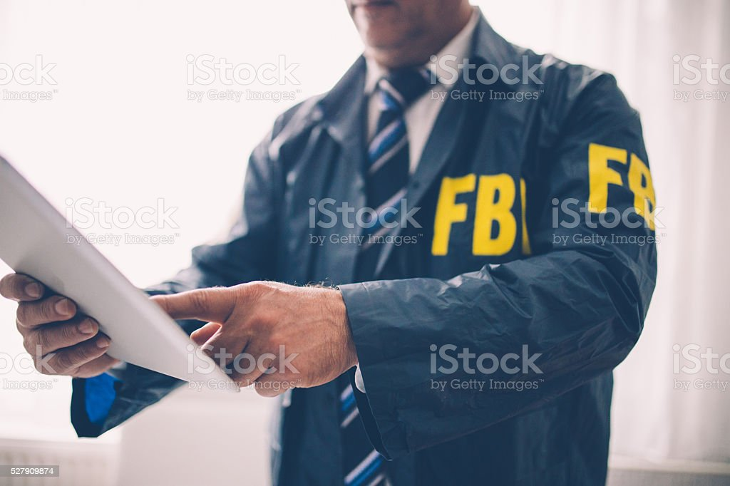Special agent holding documents stock photo