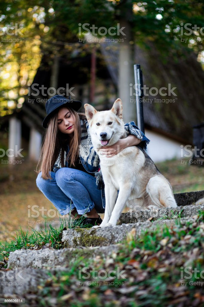 Portrait of Pretty Girl And Her Loving Pet on Autumn Day in Natural...