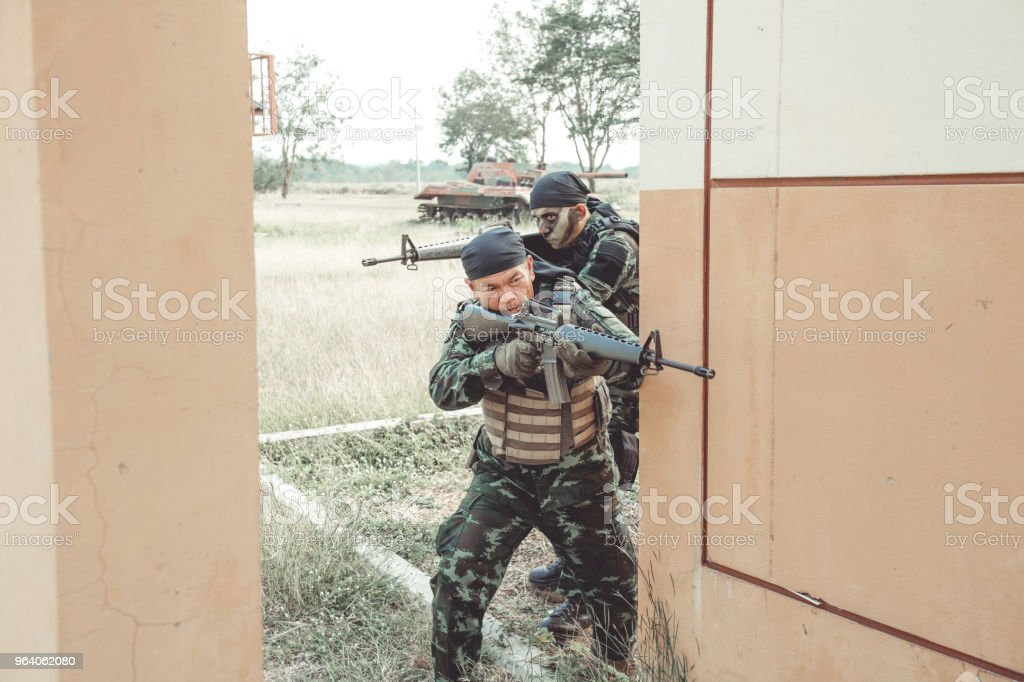 Special force soldiers in urban combat training.  Breach and entry building. Chinese soldiers in full combat gear, green digital cammo. - Royalty-free Army Stock Photo