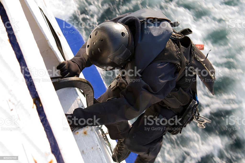 Special Forces (Sondereinheit SWAT) Agent Climbing into a Moving Ship stock photo