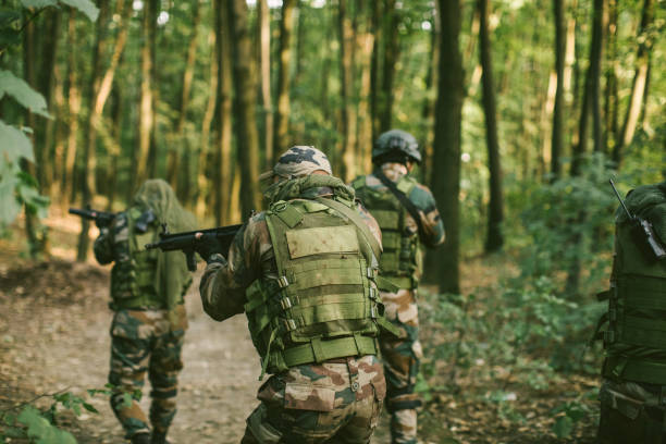 Special Forces Inspecting Wild Scenery Military Forces Armed With Machine Guns Exploring Wild Area ambush stock pictures, royalty-free photos & images