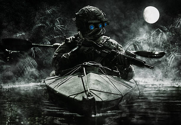 special forces operators with night vision goggles stock photo