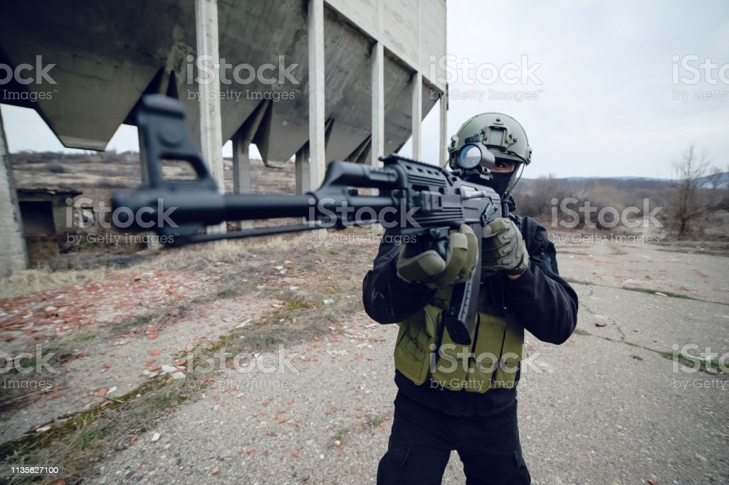 Special Forces Police Soldier Armed With Machine Gun Aiming Ready To Attack Stock Photo Download Image Now