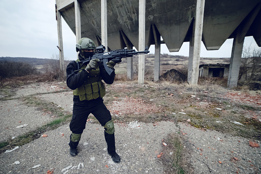 Special Forces Police Soldier Armed With Machine Gun Aiming