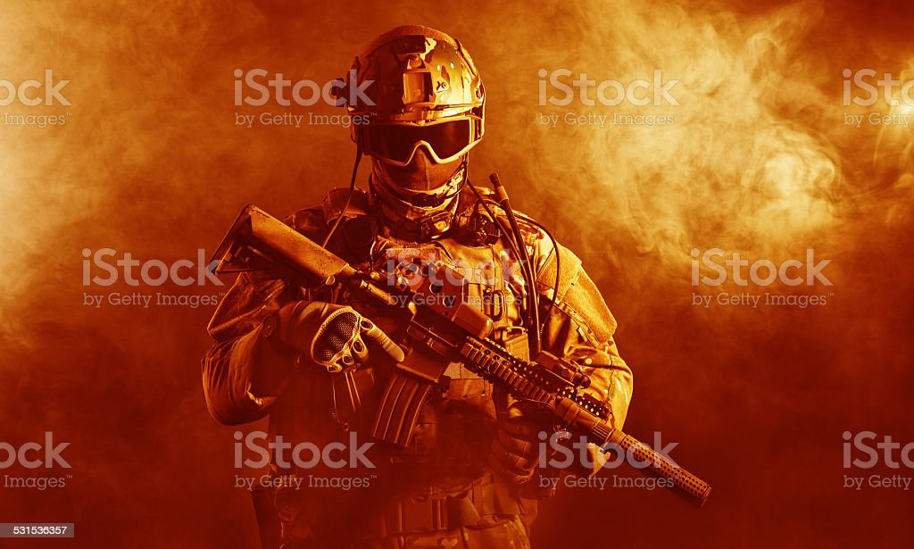 Special forces soldier in the fire stock photo