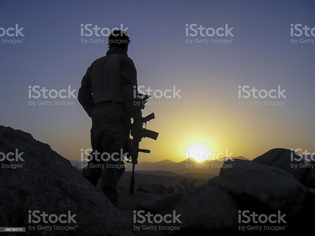Special Forces soldier overlooking sunset stock photo
