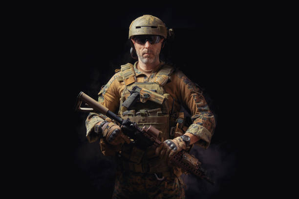 special forces soldier poses with a rifle on a black background special forces soldier of the united states poses with a rifle on a black background park ranger stock pictures, royalty-free photos & images
