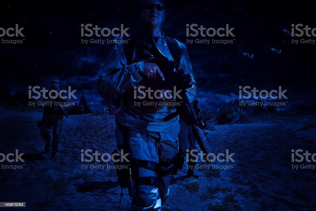 Special  Forces Squad - Night  Manuvers With  Helecopter Support royalty-free stock photo