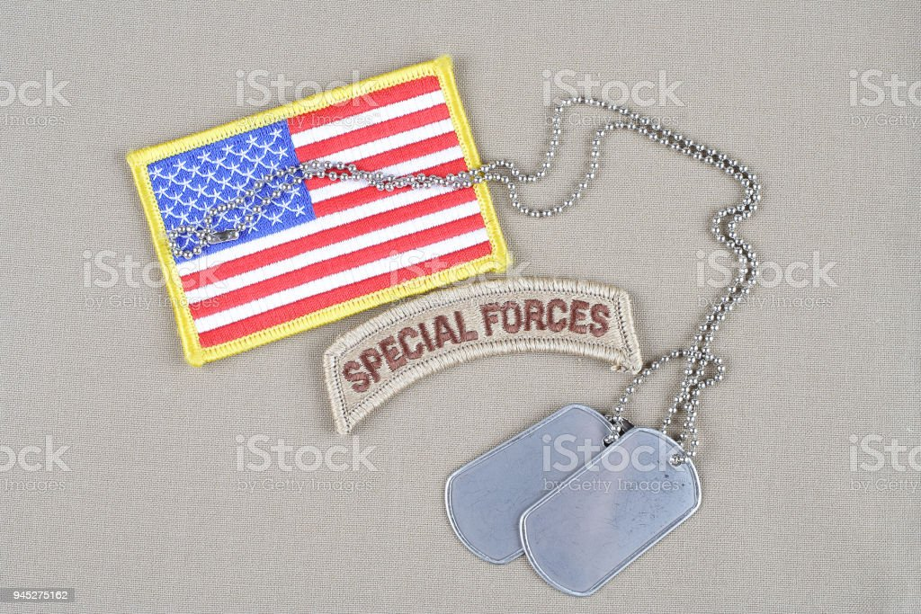 US ARMY special forces tab with dog tag stock photo