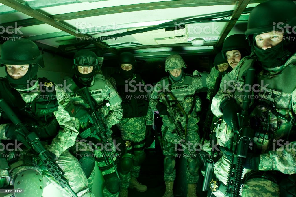 Special forces tactical unit preparing for raid stock photo