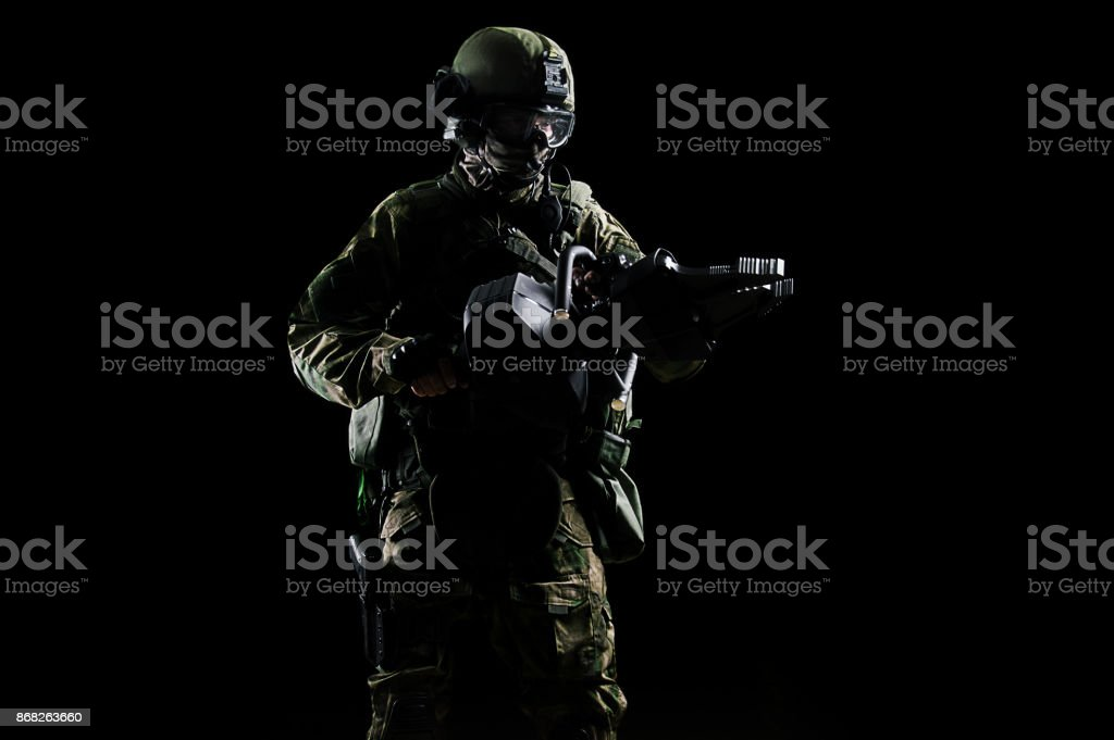 Special group soldier holds a jack to open the doors. stock photo