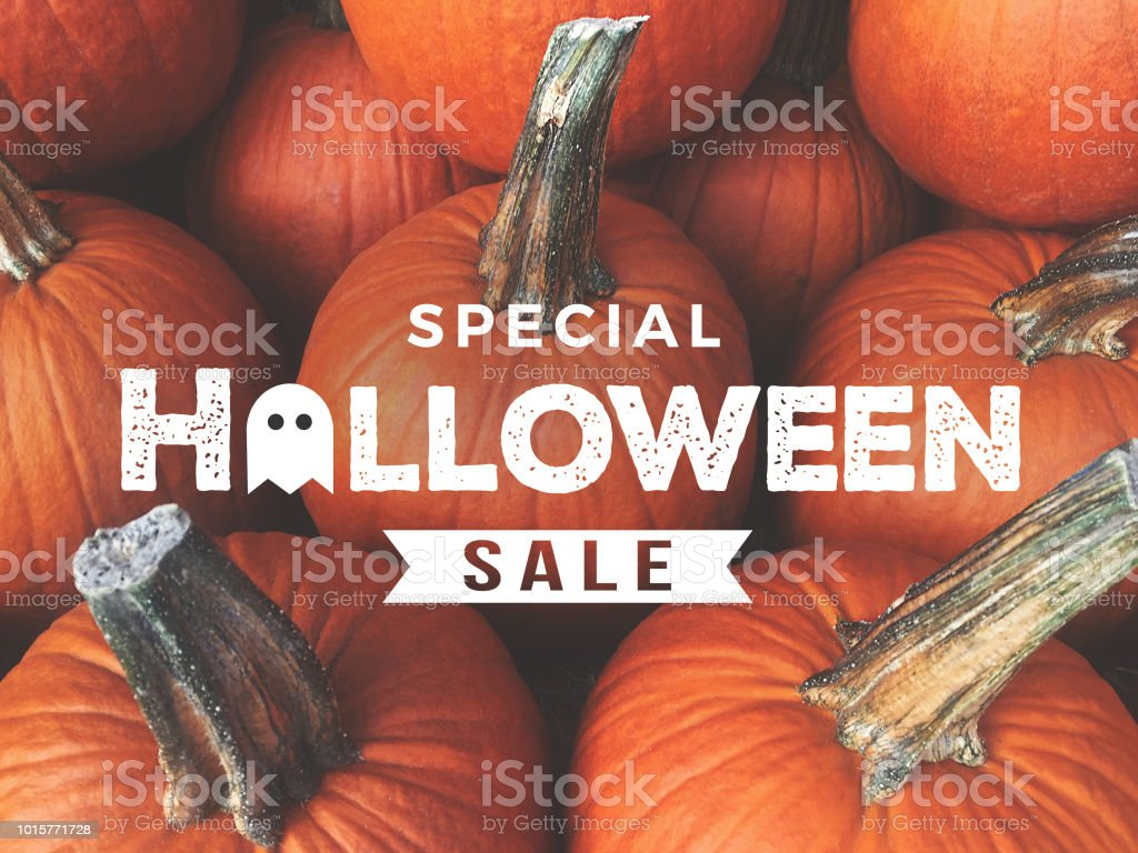 Special Halloween Sale Text Over Pumpkins Background stock photo